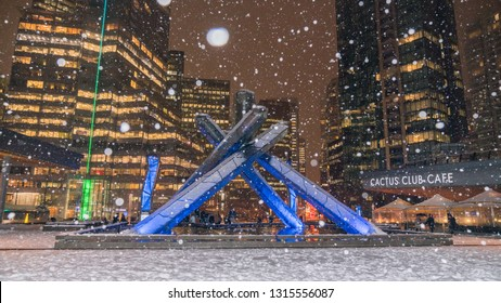 Vancouver BC Canada,February 2019. Vancouver Olympic torch with snow backgrounds