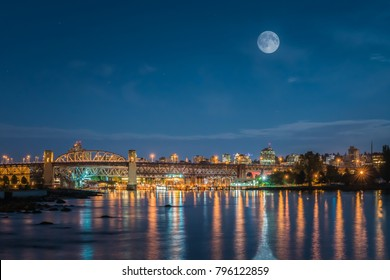 Vancouver BC Canada,May 2017. Burrard bridge Vancouver city night with full moon backgrounds