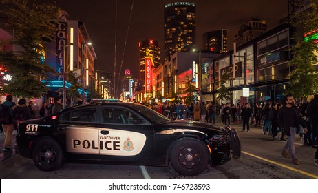 Vancouver BC Canada,October 31 2017.Vancouver police car on Halloween party at Granville street,Vancouver Downtown Canada