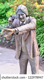 VANCOUVER BC, JUNE 15: The photographer statue in Queen Elizabeth park is bronze art treasure for Vancouver BC. He acts like a magnet for tourists to take pictures on June 15, 2012 in Vancouver.