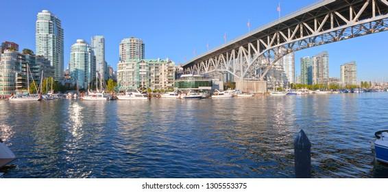 Vancouver BC skyline at False Creek river and sailboats.