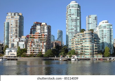 Vancouver BC skyline at False creek high rises and skyscrapers along the waterway.