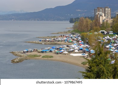 VANCOUVER, BC/Canada - April 1, 2018: The sandy beaches and overhead view of the 4-20 event where Cannabis is sold in an open, free market in Vancouver, Canada on April 20, 2018.