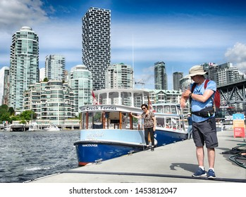 VANCOUVER, BC/Canada - July 16, 2019: A small public ferry,at Granville Island on False Creek near the downtown core on July 16, 2019.