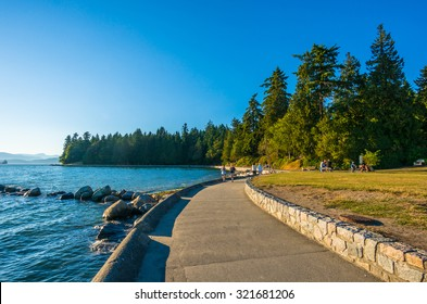 VANCOUVER, BC/CANADA - JULY 30: People at Stanley Park Seawall in Vancouver, Canada on July 30, 2015. Park visitors walk, bike, roll, and fish on the 22 kilometers seawall route.