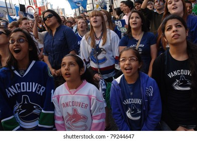 VANCOUVER, BC,CANADA - JUNE 10: Vancouver Canucks fans watch the Stanley Cup 2011 Finals Game 5 Vancouver Canucks vs. Boston Bruins on June 10, 2011 in Downtown Vancouver, Canada