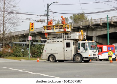 VANCOUVER, BC/Canada - March 7, 2018: A specialized vehicle with an elevated hydraulic platform is used to help hydro crews working on urban overhead power lines in Vancouver, Canada on March 7, 2018.