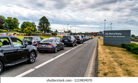 Vancouver - Blaine Hwy, Surrey, British Columbia, Canada. 06. 24. 2018. Long Line up cars at the Canada - US Peace Arch border crossing.