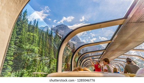 Vancouver, British Columbia / Canada - 06/17/2015 Rocky Mountaineer train traveling through the Rocky Mountains with luxury dining on board.
