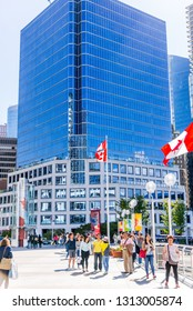 Vancouver,  British Columbia / Canada - 07/01/2015. Canadian flags everywhere and people enjoying the surroundings at Canada Place, Vancouver Harbour on Canada Day