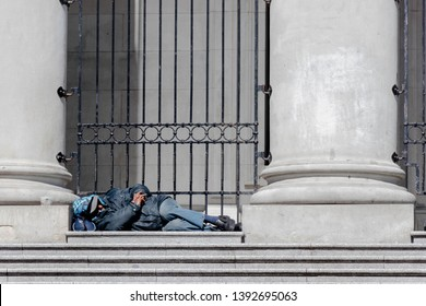 Vancouver, British Columbia / Canada - April 27, 2019: Someone sleeps on the stairs of Robson Square in Vancouver on April 27, 2019.