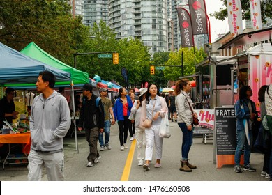 Vancouver, British Columbia / Canada - August 10, 2019: Crowds of people walking along an array of food stalls and stands during the Vancouver Chinese Festival 2019