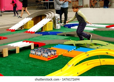 Vancouver, British Columbia / Canada - August 10, 2019: Young boy playing with racecars