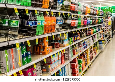 Vancouver, British Columbia / Canada - July 8th 2018 - The Pop Aisle in a Grocery Store with many brand name Sugary Drinks