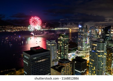 Vancouver, British Columbia, Canada - July 1, 2018: Aerial view of the modern Downtown City Skyline during the Fireworks at Canada Day Celebration.