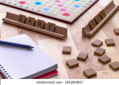 """Vancouver, British Columbia, Canada, - July 13, 2019 - Scrabble board game with the scrabble tile spell """"Game Day"""""""