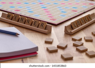 """Vancouver, British Columbia, Canada, - July 13, 2019 - Scrabble board game with the scrabble tile spell """"Winner Loser"""""""