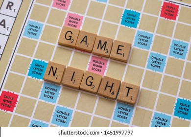 """Vancouver, British Columbia, Canada, - July 13, 2019 - Scrabble board game with the scrabble tile spell """"Game Night"""""""