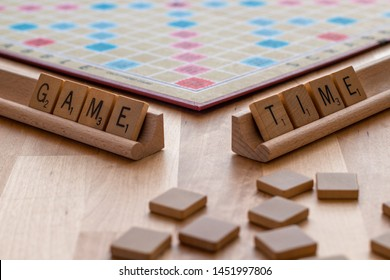 "Vancouver, British Columbia, Canada, - July 13, 2019 - Scrabble board game with the scrabble tile spell ""Game Time"""