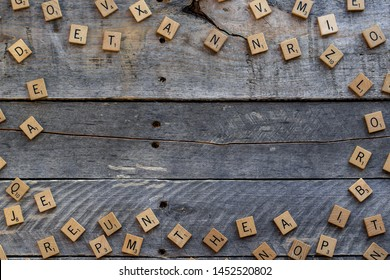 Vancouver, British Columbia, Canada, - July 13, 2019 - Scrabble tiles created a border on a wooden background