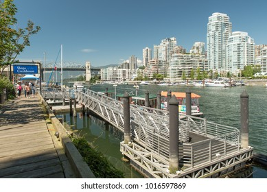Vancouver, British Columbia, Canada - June 28, 2016:  Looking west across False Creek at Downtown from Granville Island with Burrard Street Bridge in the background.