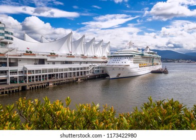 Vancouver, British Columbia, Canada - June 1, 2018.  Vancouver Convention Center with docked cruise ship Radiance of the Seas.