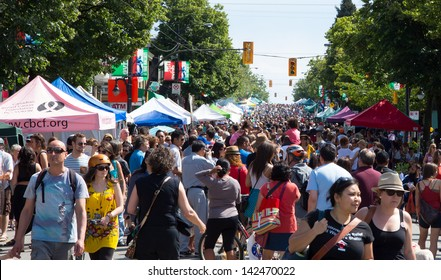 VANCOUVER, BRITISH COLUMBIA, CANADA - JUNE 16: Crowds enjoying car free day on Commercial Drive on June 16,2013 in Vancouver, Canada