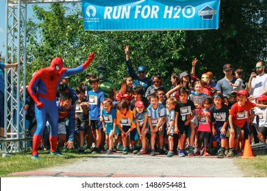 Vancouver, British Columbia/ Canada - June 15, 2019: Young children participating in Run For H2O 2019. Kids Running. Spiderman. Fun. Summer.