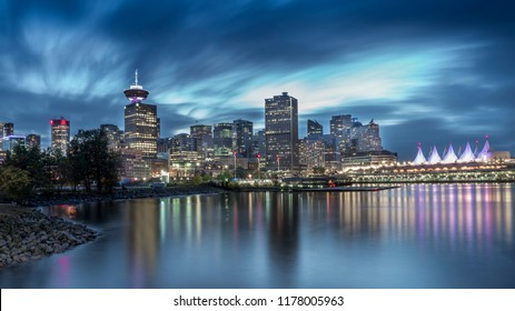 Vancouver, British Columbia - Canada. Long exposure of Downtown Vancouver on a dramatic sky after a rain. Beautiful city mirroring in the pacific shore. Beautiful British Columbia, Canada.