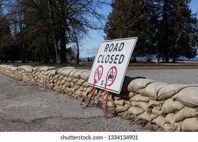 """""""Vancouver, British Columbia / Canada - March 9 2019: Vancouver Spanish Banks flood mitigation and sand bags"""""""