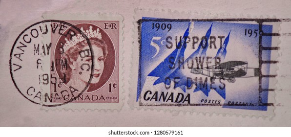 Vancouver, British Columbia / Canada - May 8th 1959 : Postal mark on a 1954, 1 cent Canada stamp and 1959 Canada 5 cent stamp.