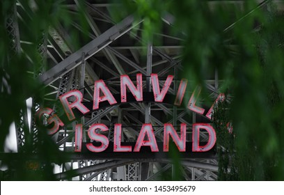 Vancouver, British Columbia / Canada: May 27 2019: Sign for Granville Island in Vancouver, Canada.  Under a bridge leading to the island.