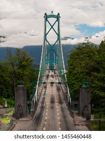 Vancouver, British Columbia / Canada - May 21 2019: Lions gate bridge in Vancouver, Canada long exposure with blurry traffic going over the bridge.