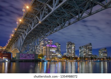 Vancouver, British Columbia / Canada - October 9, 2018: Granville Street bridge and downtown Vancouver from Granville Island.