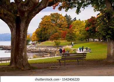 VANCOUVER, BRITISH COLUMBIA, CANADA - OCTOBER 14, 2017: People enjoying an autumn day in Stanley Park in Vancouver, BC, Canada