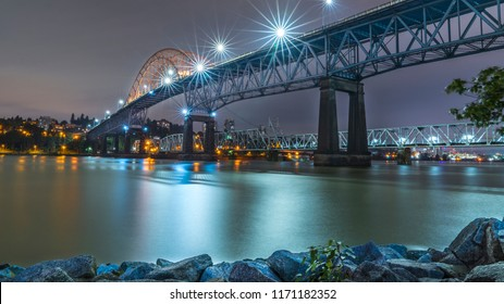 Vancouver, British Columbia - Canada. Pattullo Bridge, Surrey to New Westminster. Long exposure of the bridge over the water. Sky Train Bridge. Beautiful British Columbia, Canada.