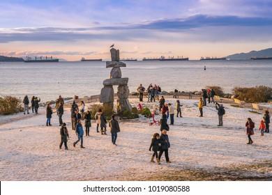 Vancouver British Columbia Canada,January 2017. people visiting Inukshuk Vancouver at English bay beach,Canada