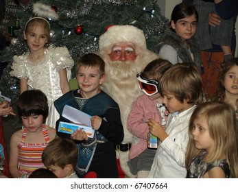 VANCOUVER, BRITISH COLUMBIA - DECEMBER 12: Unidentified children with Santa Claus at the celebration of Christmas in  in downtown Vancouver on December 12, 2010