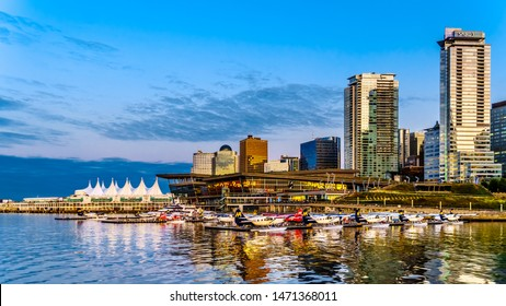 Vancouver, British Columbia/Canada - July 11, 2019: Float Plane Terminal and High Rise Buildings form the Downtown and Coal Harbour skyline. Viewed from a Harbor Cruise ship the Vancouver Harbor