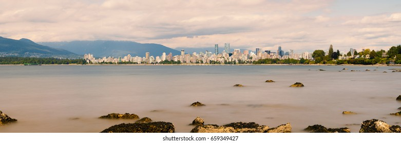 VANCOUVER, BRITISH COLUMBIA/CANADA - June 11, 2017: Panorama of Vancouver photographed between Jericho Beach and Kitsilano Beach.