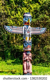 Vancouver. British Columbia/Canada-May 24, 2019: The colorful 'Thunderbird House Post Totem Pole' The totem pole has a Thunderbird at the top, then below that a Grizzly bear holding a human