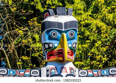 Vancouver. British Columbia/Canada-May 24, 2019: The top of the colorful 'Thunderbird House Post Totem Pole' depicting a Thunderbird in Stanley Park, Vancouver, Canada
