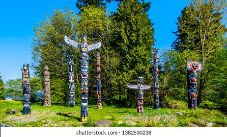 Vancouver. British Columbia/Canada-May 24, 2019: Colorful indigenous Totem Poles representing art and religious symbols of West Coast Indigenous peoples placed in Stanley Park in Vancouver, Canada