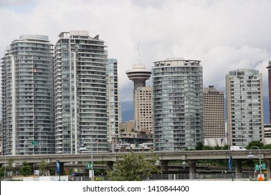 Vancouver, Canada - 06/23/2011 : Cityscape of Vancouver with apartment building and Vancouver Tower in background