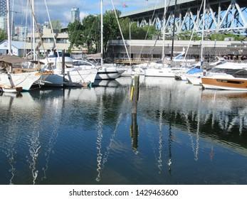 Vancouver, Canada - 19th June, 2019: Boats on False Creek by Granville Island under the Granville Street bridge