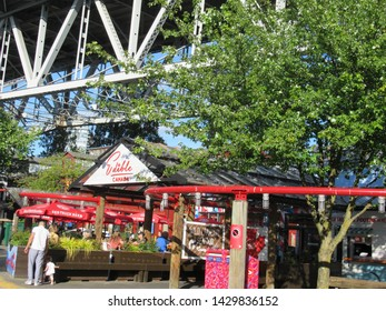 Vancouver, Canada - 19th June, 2019: The entrance to Edible Canada at Granville Island under the Granville Street bridge