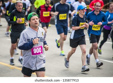 VANCOUVER, CANADA - APRIL 21:  Actor Sean Astin (#900) in the Vancouver Sun Run, April 21, 2013. Many runners wore blue and yellow in support of the Boston marathon, where bombings occurred earlier.