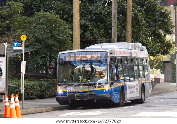 "Vancouver, Canada - April 2,2020: Translink bus with sign ""Rear Boarding Only"" due to COVID-19"