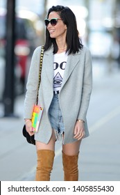 VANCOUVER, CANADA - APRIL 24, 2017: Olivia Munn wears Daisy Duke Ripped Denim Shorts attending TED Talks IN Vancouver, Canada