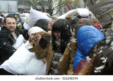 VANCOUVER, CANADA - APRIL 5, 2014: Feathers went flying as hundreds of people came armed with their pillows to celebrate the International Pillow Fight Day 2014 in Vancouver, Canada, April 5, 2014.